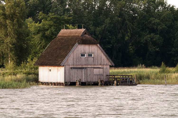 Bodden EyeEmNewHere Nature Reserve Architecture Backgrounds Building Exterior Calendar Day Evening Fisherman Hut Lake Nature Nature Experiences Nature_collection No People Outdoors Season  Tourism Tree Water Wood - Material