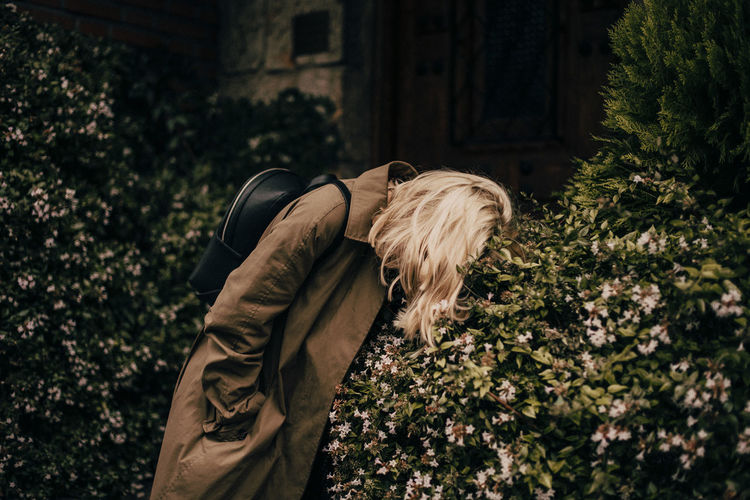 Side view of woman standing by plants