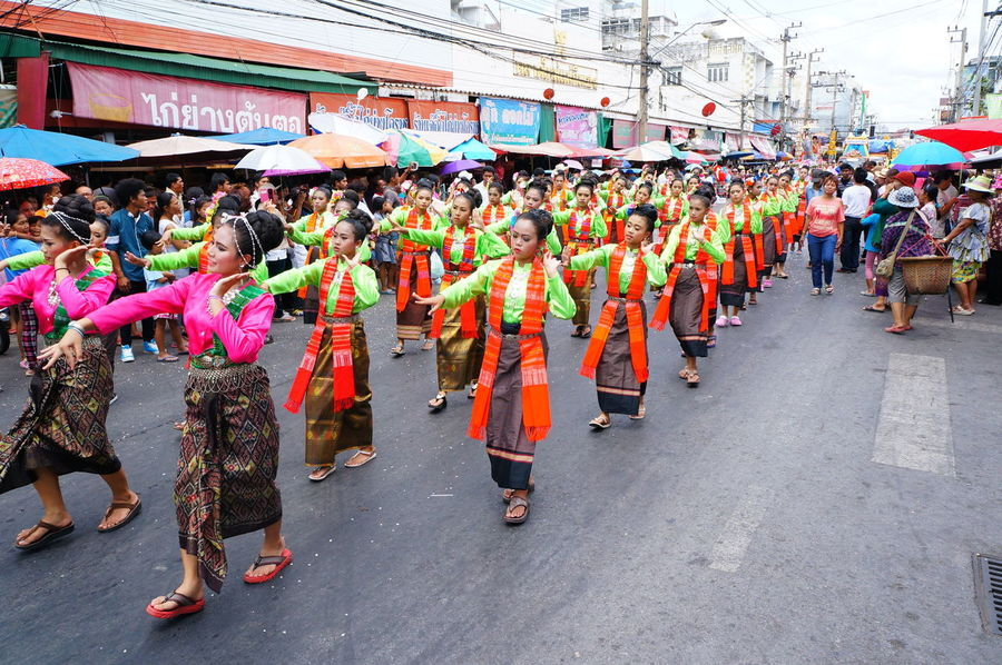 Parade dancers in the Candle Festival Array Celebration Colour Contest Cultural Custom Dance Editorial  Female Heritage Lady Large Group Of People Outdoors Pageantry Parade People Person Procession Real People Social Thailand Tradition Traditional Clothing Travel Women