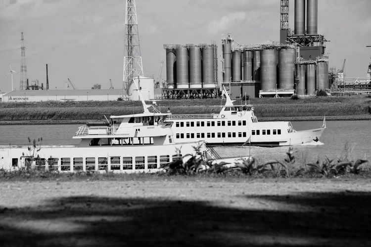 Day Outdoors Transportation No People Sky Nautical Vessel Industry Water Nature Architecture Animal Themes Oil Pump Outdoor Photography Black And White Photography Black & White Ships Factory Landscape Factories Boat Schelde
