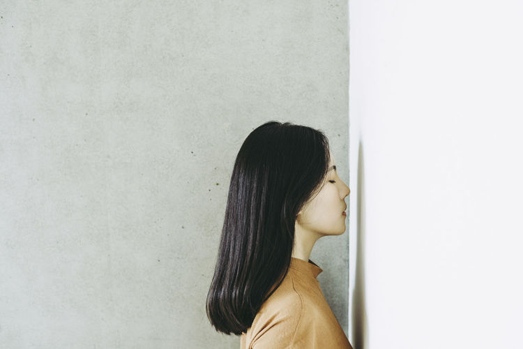 Adult Adults Only Black Hair Day Indoors  One Person One Woman Only One Young Woman Only People Real People Standing White Background Women Young Adult Young Women The Fashion Photographer - 2018 EyeEm Awards