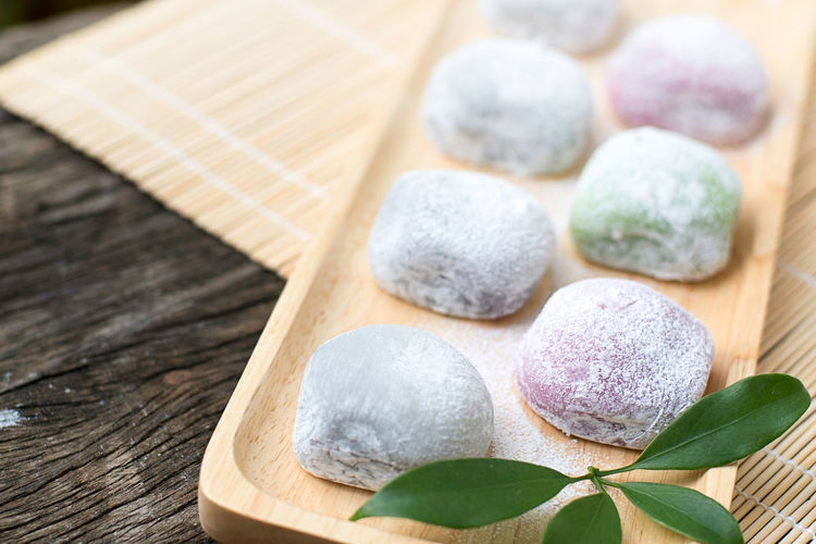 Traditional Japanese confectionery desert Daifuku Mochi, Daifuku means great luck is made of round mochi or glutinous rice cake stuffed with sweeten red bean paste made from azuki beans Bamboo Mat Glutinous Rice Japanese  Japanese Confectionery Multi Colors Azuki Beans Bakery Close-up Creamic Tile Daifuku Mochi Food And Drink Glutinous Rice Cake Great Luck Indulgence Japanses Culture Japanses Garden Mochi No People Outdoor Photography Red Bean Paste Rice Cake Round Mochi Still Life Traditional Japanese Confectionery Wood - Material