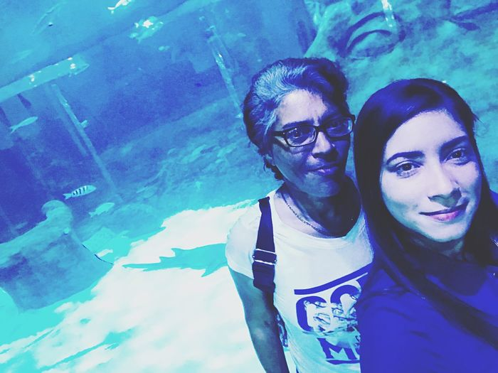 Blue Aquarium Two People Togetherness Lifestyles Couple - Relationship Real People Young Men Leisure Activity Bonding Emotion Looking At Camera People Glasses Young Women Women