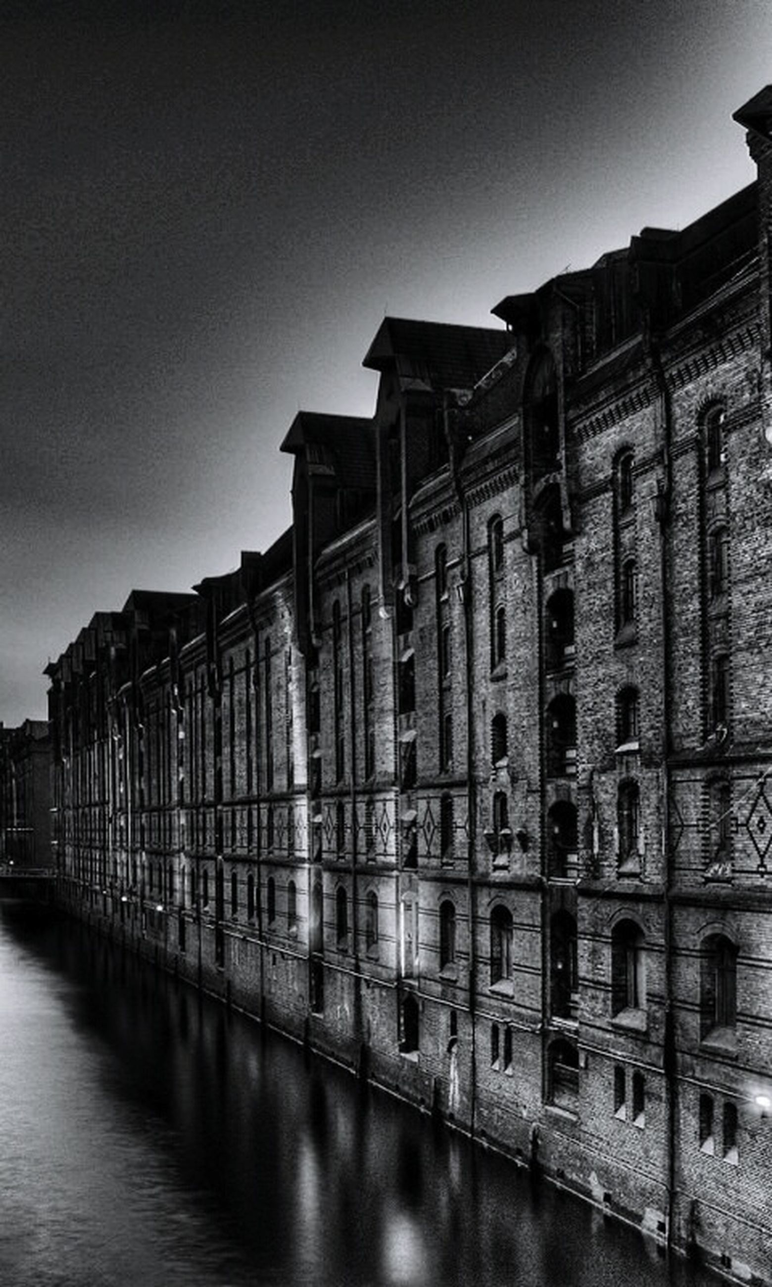architecture, built structure, building exterior, water, reflection, waterfront, clear sky, sky, canal, city, river, outdoors, history, travel destinations, building, transportation, window, no people, day, travel