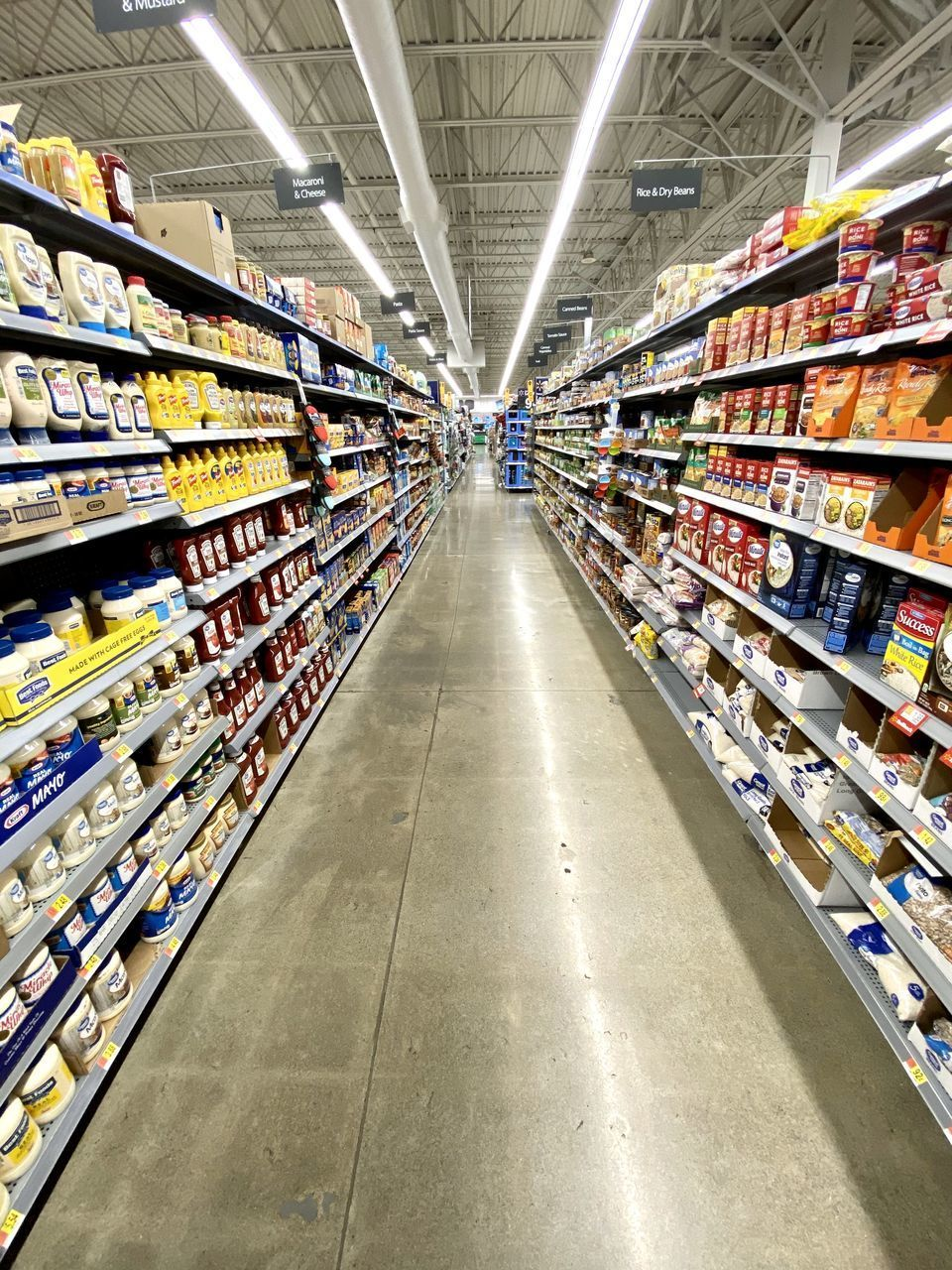 supermarket, store, retail, shopping, choice, shelf, consumerism, variation, food and drink, indoors, food, aisle, abundance, groceries, no people, order, large group of objects, market, shopping cart, arrangement, flooring, diminishing perspective, tiled floor, ceiling