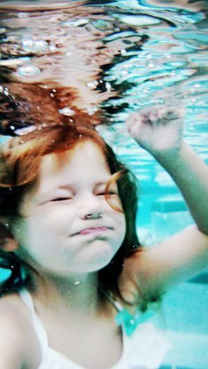 Tiny swimmer experiments with going under water. Enjoying Life Underwater Summer Swimming Daytonabeach Snapshots Of Life