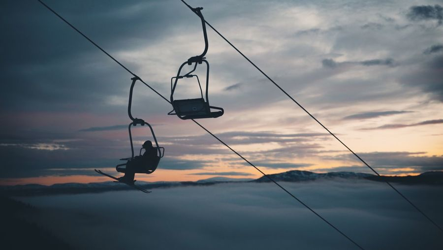 Silhouette Of Person In A Chairlift
