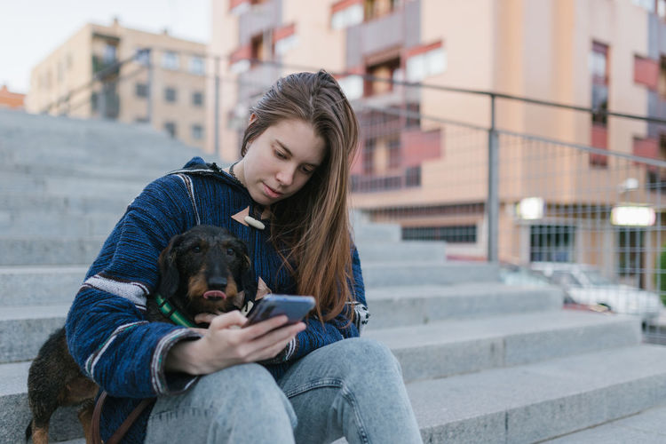 Portrait of a teenage girl with dog