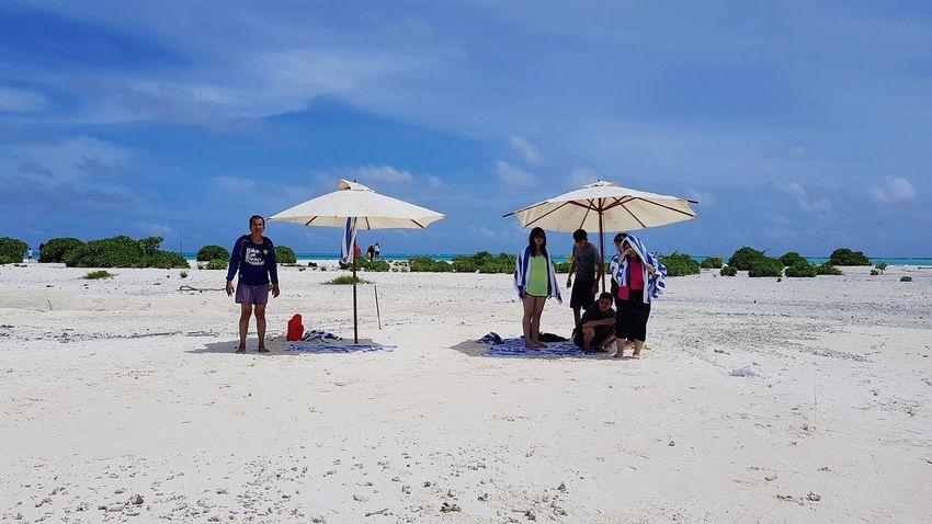 🙎♂️ vs 👨👩👧👦 Maldives Maldives Islands Maldivesphotography PhonePhotography Friendship Beach Sea Water Sand Summer Relaxation Men Full Length Togetherness Beach Umbrella Shelter
