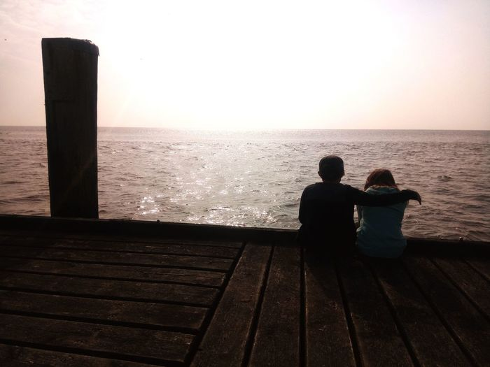 Water Sea Beach Men Relaxation Sitting Togetherness Silhouette Rear View Sunset Friend Pier HUAWEI Photo Award: After Dark The Minimalist - 2019 EyeEm Awards