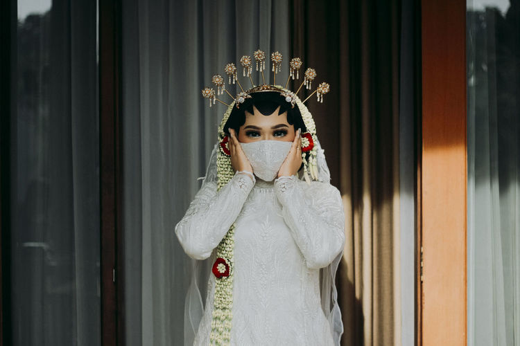 Portrait of bride wearing face mask