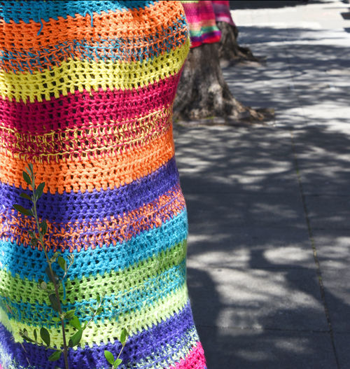 Trees covered in colourful knitting City City Life Colourful Happy Knitting Rainbow Colors Street Arts  Stripes Tree Trunk Abstract Bunt Close-up Colorful Focus On Foreground Light And Shadow Multi Colored No People Outdoors Street Art Street Scene Striped Pattern Texture Tree Bombing Urban Urban Interventions