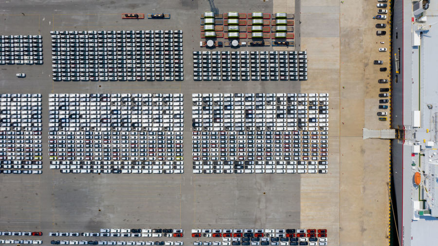New car line up parking lot automobile factory export international dealers by shipping