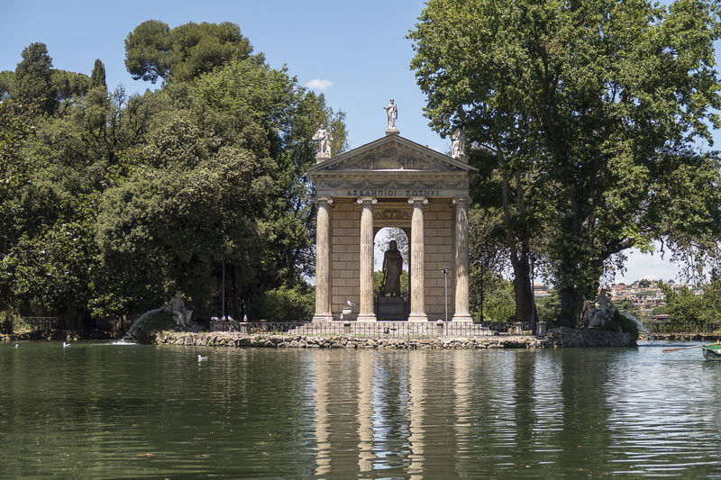 Rome Italy. Temple of Asclepius (Tempio di Esculapio) at Villa Borghese gardens. Visitors can rent boats to row for a limited time at the small lake by the temple. Architecture Touristic Borghese Borghese Gardens Capital Cities  Famous Place Historical Building Italia Italy Lake Lake In Rome Landmark Monument Roma Roman Roman Lake Rome Rome Gardens Rome Italy Tempio Di Esculapio Temple Of Asclepius Rome Tourism Tourism Destination Travel Photography Villa Borghese Gardens Moving Around Rome