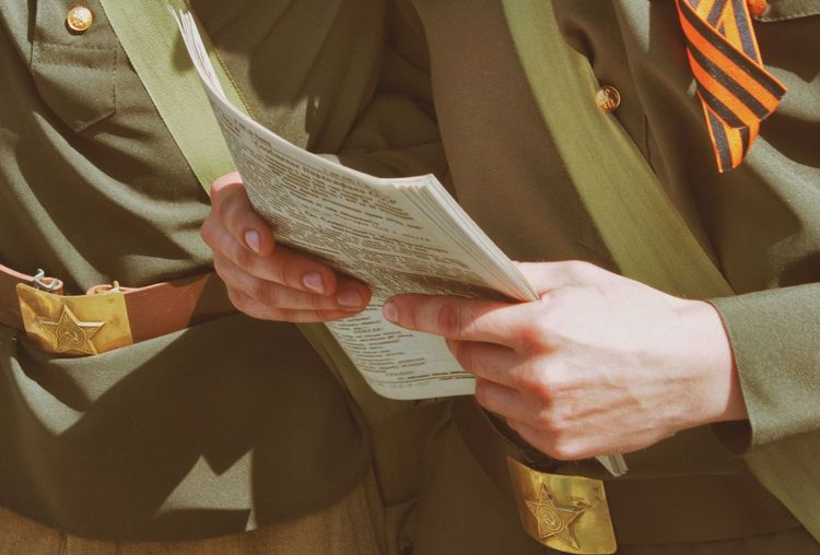 Military officers holding papers on victory day