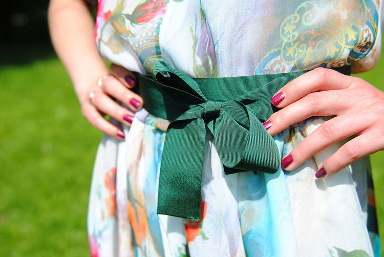 details of fashion Adult Backgrounds Belt  Business Finance And Industry Casual Clothing Celebration Close-up Day Fashion Fashion&love&beauty Green Belt Holding Human Body Part Human Body Parts Human Hand Industry Manicure Men Midsection Outdoors People Real People Summer Dress Well-dressed Women