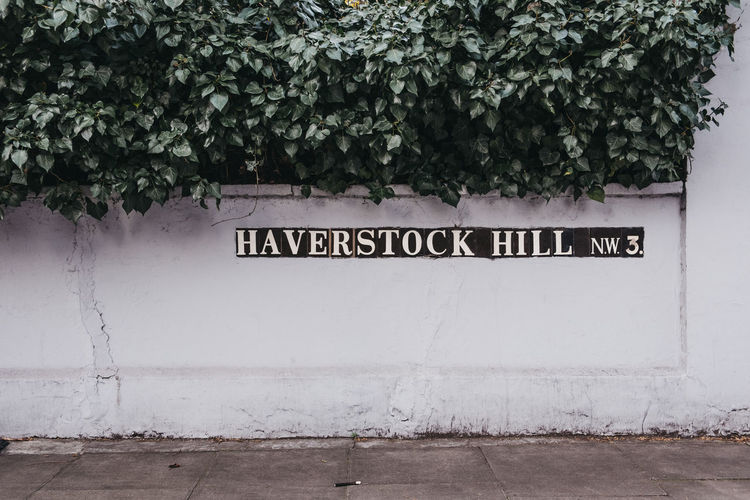 Street name sign on Haverstock Hill, Belsize Park, an upscale area of North London. Outdoors Wall No People Day Information Sign Wall - Building Feature Architecture Information Sign Communication Text Europe England North London Street Name Sign Belsize Park Uk London