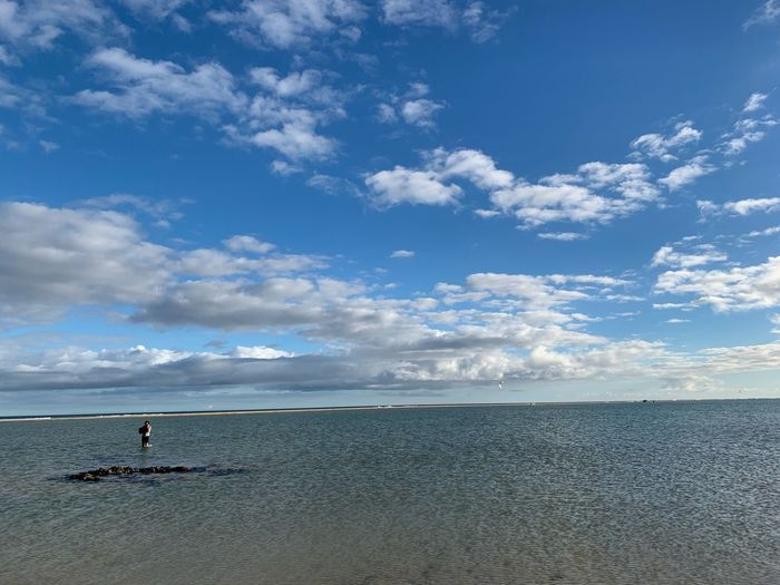 Cloud - Sky Sky Water Sea Scenics - Nature Beauty In Nature Tranquility Day Nature Idyllic Non-urban Scene Real People Tranquil Scene Outdoors Land Beach Holiday Vacations One Person