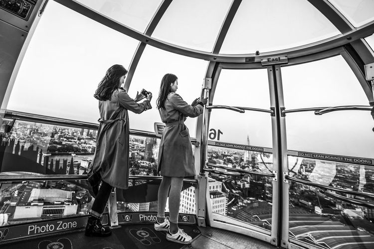 """""""Photo Zone Arts Culture And Entertainment City Lifestyles London Eye People Tourism Tourist Travel Travel Destinations Two People Women Young Women Women Around The World"""