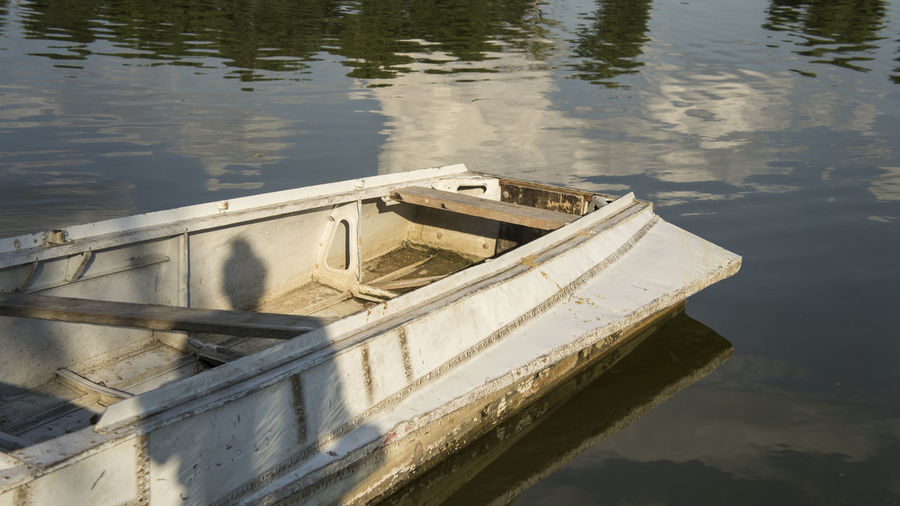High angle view of abandoned boat moored in lake