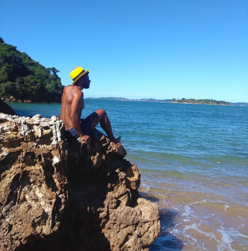Buzios Happy Rio De Janeiro Rocky Sitting Vacations Wave Bearded Beauty In Nature Blue Carioca Day Jumping Leisure Activity Lifestyles Motion Photography One Person Outdoors Real People Sand Sea Sky Water Waterfront Summer Exploratorium