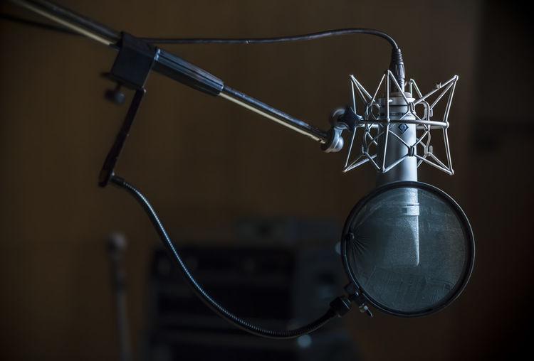 Close-up of condenser microphone in recording studio