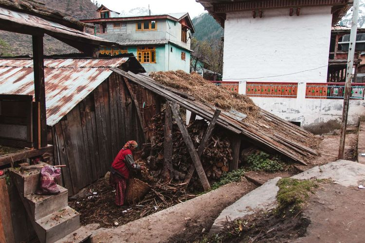 Man working on house of building