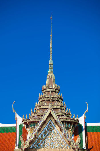View of temple against blue sky