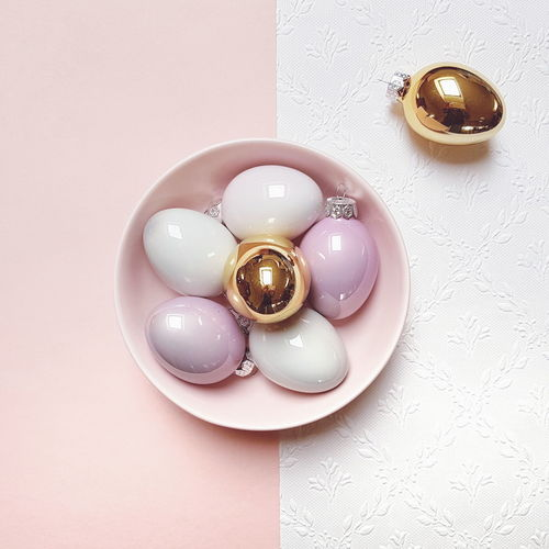 Easter Easter Eggs Pink Color Golden Egg White Background Studio Shot Celebration Table High Angle View Still Life Shiny Circle Close-up