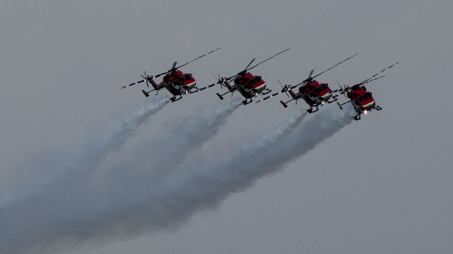 Indian Army Helicopters IAF Indian Army Sky Mode Of Transport Low Angle View Transportation Extreme Sports Outdoors Teamwork Air Vehicle Nature Red Day Men Real People Airshow People