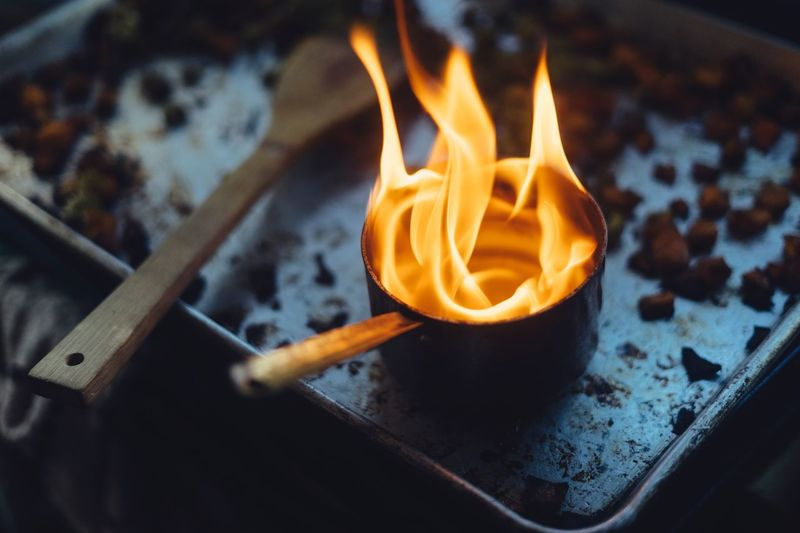 High angle view of candles on barbecue grill