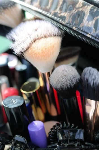 Close-up of make-up on table