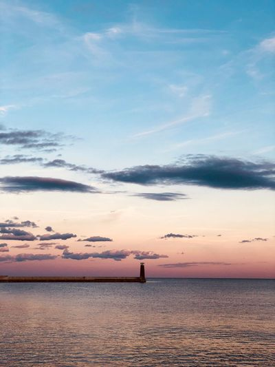 Sky Water Scenics - Nature Beauty In Nature Cloud - Sky Sea Sunset Tranquil Scene Tranquility Idyllic Nature Non-urban Scene Horizon Beach Land Horizon Over Water Waterfront Orange Color Real People Outdoors