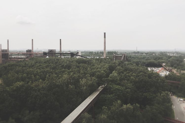 Industry View View From Above Zeche Zollverein Coalmine Nature Trees Forest IPhoneography Iphone6s Buildings Building Chimney Chimneys Industry Ferris Wheel Grey Sky Conveyor  Conveyor Belt Belt Conveyor Showcase June The Mix Up