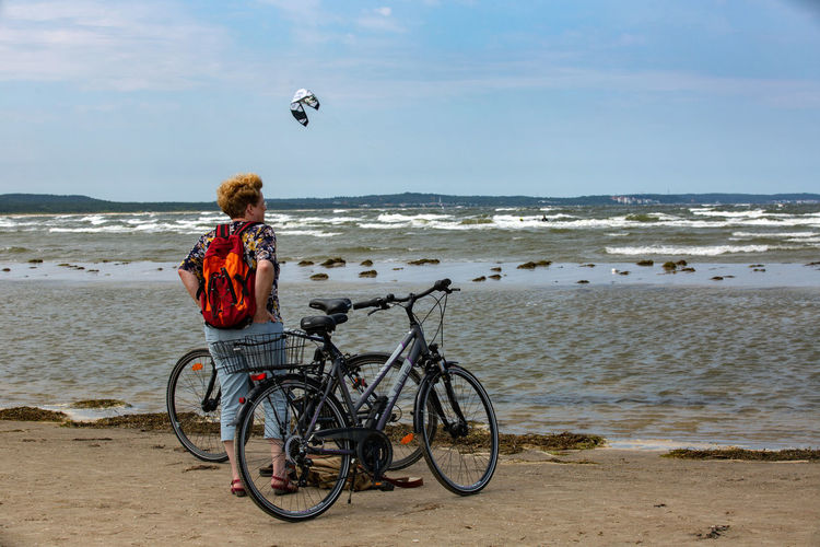 Baltic Baltic Sea Beach Beauty In Nature Bicycle Horizon Horizon Over Water Land Leisure Activity Lifestyles Mode Of Transportation Motion Nature One Person Outdoors Real People Sea Sky Transportation Water Wave