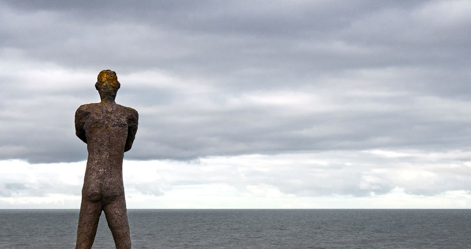 Statue against sea and sky