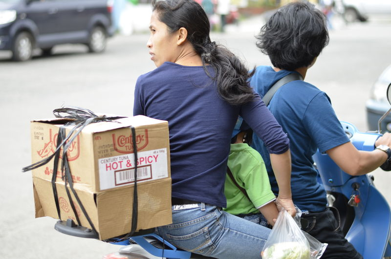 Car Cardboard Box Cultures Land Vehicle Life Lifestyles Market Marketplace Outdoors People Philippines Real People Rear View Road Social Issues Society Standing Still Life Street Street Photography Streetphotography The Photojournalist - 2017 EyeEm Awards The Street Photographer - 2017 EyeEm Awards Transportation Women