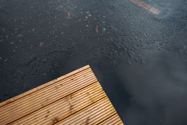 High angle view of wet window during rainy season
