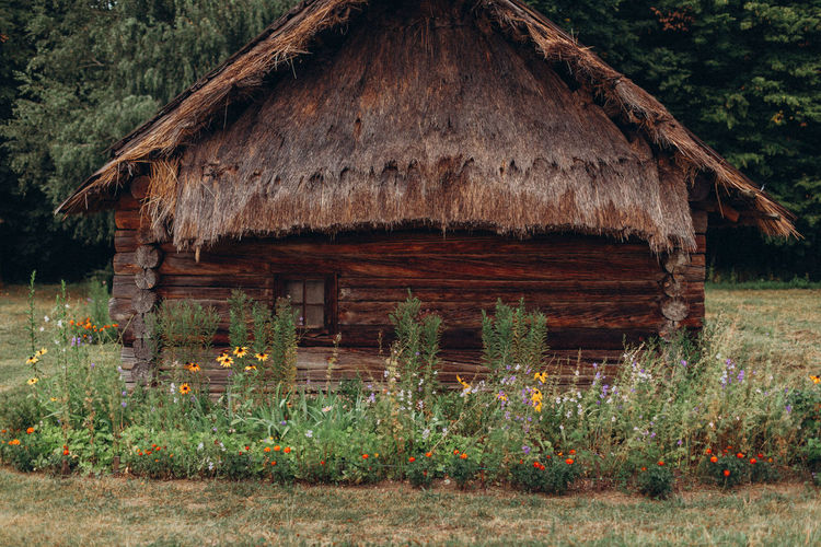 Old wooden house on field