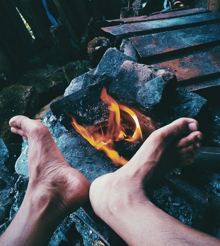 High angle view of hand holding fire