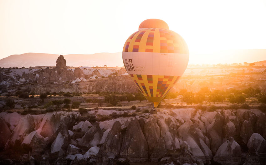 Hot Air Balloons Ballooning Festival Beauty In Nature Clear Sky Day Flying Hot Air Balloon Landscape Mountain Mountain Range Nature No People Outdoors Scenics Sky Sunrise Sunrise_sunsets_aroundworld Sunset Tree