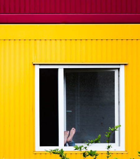 Building Exterior Close-up Day Human Body Part Multi Colored One Person Outdoors People Tree Window Yellow Paint The Town Yellow Feets Real People Façade Asylum Container Refugees Relaxing Enjoying Life Streetphotography Urban Photography Minimalist Architecture Pattern, Texture, Shape And Form Minimalobsession Fresh on Market 2017 EyeEm Ready   The Graphic City Colour Your Horizn The Photojournalist - 2018 EyeEm Awards The Street Photographer - 2018 EyeEm Awards