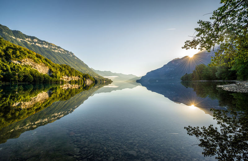 Reflection Sky Water Beauty In Nature Tranquility Idyllic Outdoors Clear Sky Reflection Lake Lake Of Brienz Brienzersee Lake Nature Mountain Green Morning Light Morning Sun Sunrise Sun