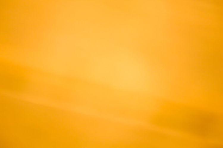 Full frame shot of yellow orange background