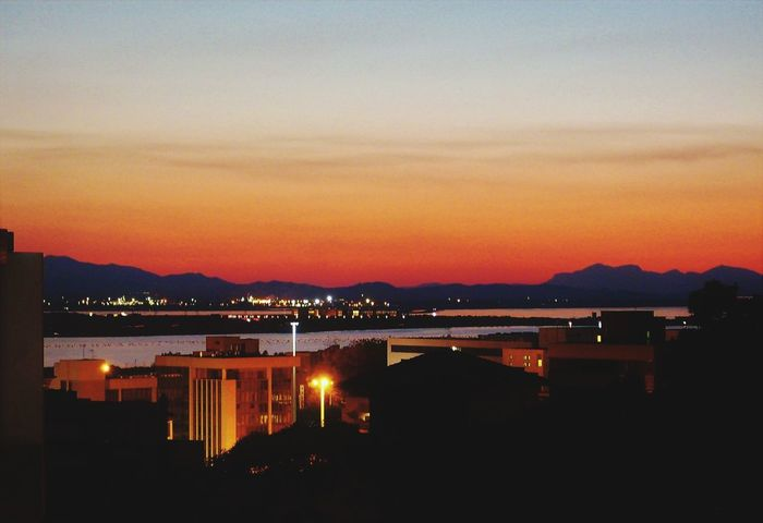 Cagliari By Night View From The Balcony City Cityscape Illuminated Astronomy Sunset Mountain Urban Skyline Water Sky Architecture Calm Romantic Sky Atmospheric Mood Atmosphere