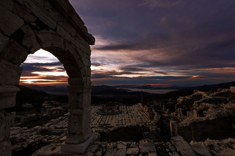 View of old ruins against sky during sunset