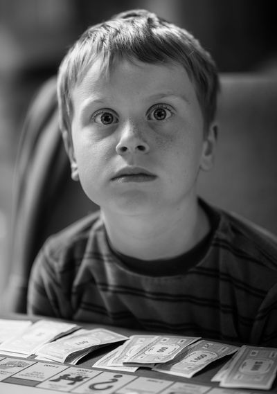 Portrait of boy with book on table