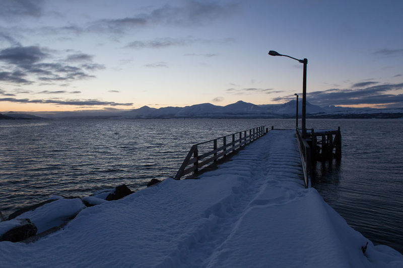 Arctic Calm City Cold Diminishing Perspective Dusk Fjord Frozen Jetty Non-urban Scene Norway Outdoors Pier Polar Night Quay Scenics Snow Sunset The Way Forward Tranquil Scene Tranquility Troms Tromsø Water Winter