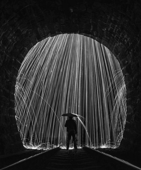 Welcome To Black Standing Real People One Man Only Architecture Night Burning Rain Umbrella Railway Blackandwhite