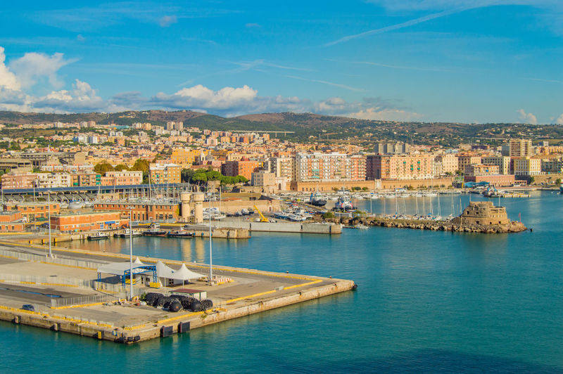 View of civitavecchia, rome's cruise and ferry port. city in the background, sunny day